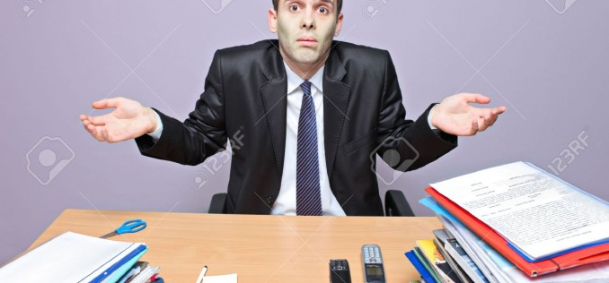 5945240-confused-businessman-in-an-office-stock-photo